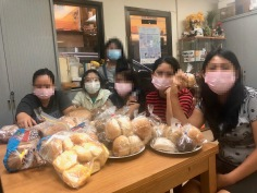 Kenyan Migrant Workers with our bread